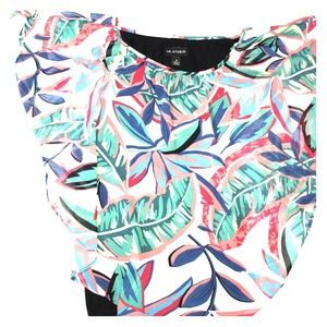 Handkerchief overlay top with tropical print.